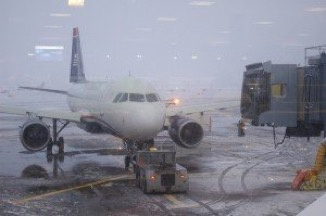 Nearly hundreds of flights were canceled in Chicago due to snowfall conditions