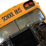 A dump truck crashes into three school buses in Libertyville
