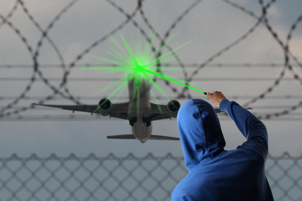 A man pleads guilty in the court for aiming laser pointer at aircraft