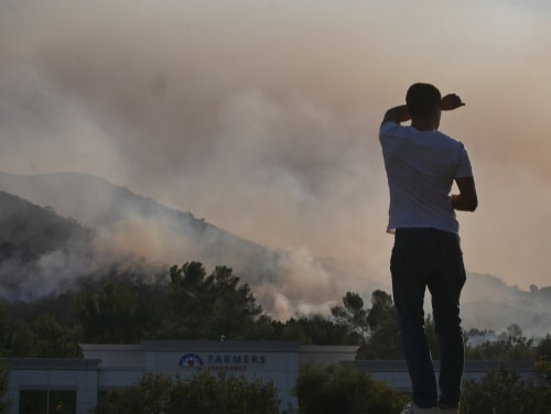 Residents near wildfire in California battle hazardous air